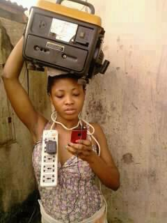 african woman with generator on head to charge phone meme